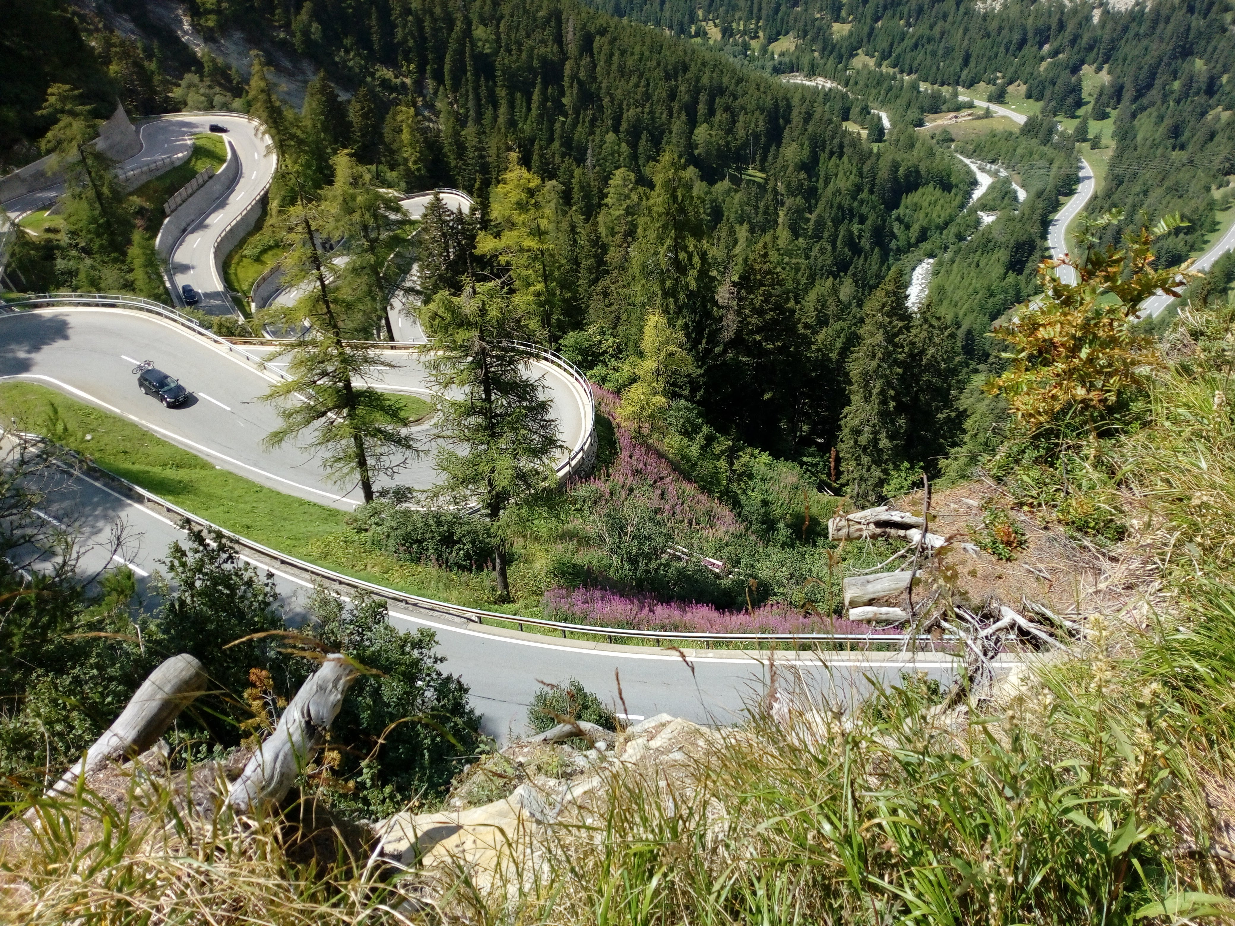 The road of the alpine pass Maloja winds up and down from and to Italy